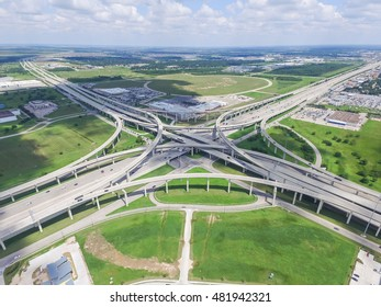 Aerial view Interstate 10 or Katy freeway with massive intersection, stack interchange, elevated road junction overpass in daytime with cloud blue sky. Aerial metropolitan area of Katy, Texas, US.