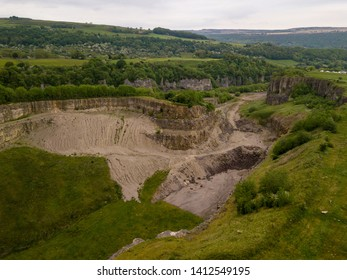 aerial view into a former limestone quarry near Derbyshire in the Peak District in UK.