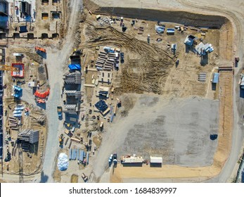Aerial view of investors and contractors on construction site with crane. New construction site with crane and building materials. San Diego, California, USA. March, 26th, 2020