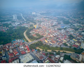 Aerial View of Ipoh City, Malaysia from top during early morning with mist clouds.