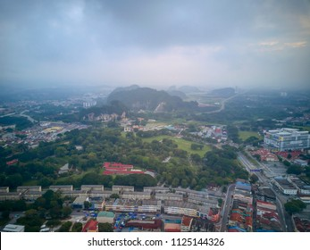 Aerial View of Ipoh City, Malaysia from top during early morning with mist clouds over the mountain.