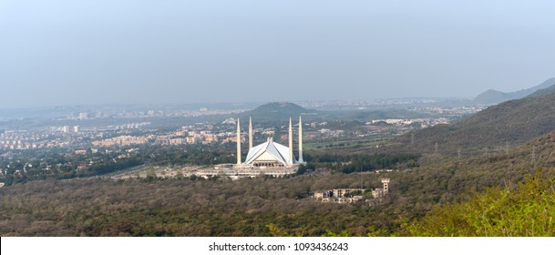 Aerial view of Islamabad city and Faisal mosque in the foothill of Margalla hills.