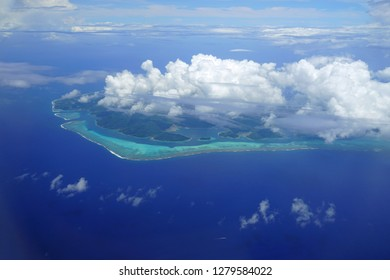 Aerial view of the island and lagoon of Huahine near Tahiti in French Polynesia, South Pacific