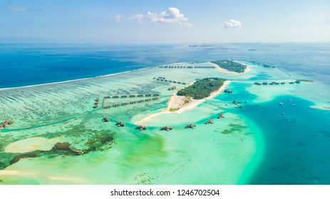 Aerial view of a island in the Maldives with turquoise lagoon