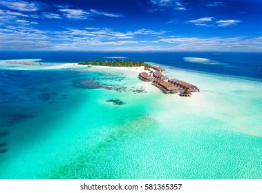 Aerial view of a island in the Maldives with turquoise waters