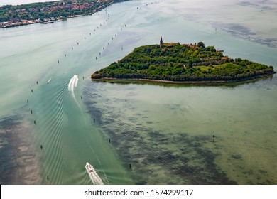 aerial view of the island of Poveglia in the Venetian lagoon, opposite Malamocco along the Canal Orfano, which connects the mouth of the port of Malamocco with Venice.