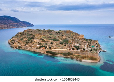 Aerial view of the island of Spinalonga with calm sea. Here were isolated lepers, humans with the Hansen's desease, gulf of Elounda, Crete, Greece.