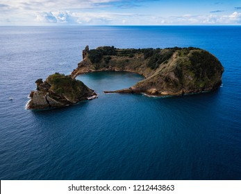 Aerial view of Islet of Vila Franca do Campo - formed by the crater of an old underwater volcano near San Miguel island, Azores archipelago, Portugal.