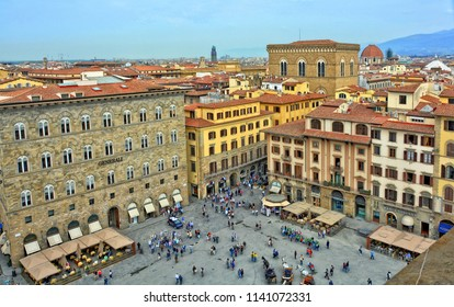 Aerial view. Italian architecture. Tourists walk in the old city. Open air restaurants. Panoramic skyline. Travel and Vacations. Signoria Square. Florence. Italy – April 17, 2018