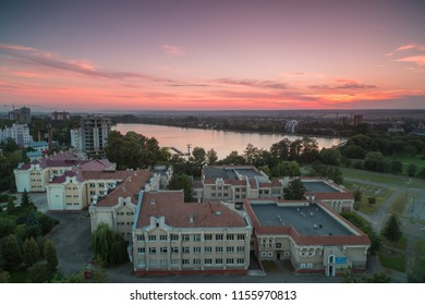 Aerial view in Ivano - frankivsk city,lake and school at sunset