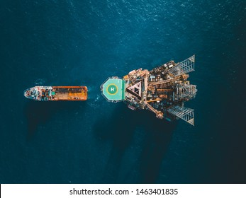 Aerial view of jack up rig with towing vessel during towing operation