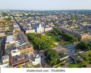 Aerial view of Jackson Square with Saint Louis Cathedral church, surround extant historical buildings from French Quarter and Washington Artillery Park in morning. New Orleans travel background.