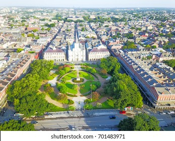 Aerial view of Jackson Square with Saint Louis Cathedral church and surrounding extant historical buildings from French Quarter in morning. The historic district section of the city of New Orleans.