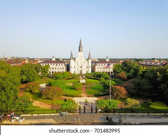 Aerial view of Jackson Square with Saint Louis Cathedral church in morning. A National Historic Landmark in New Orleans, Louisiana history. Horse and carriages wait to take people on city tours.
