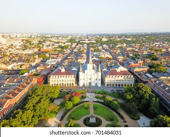 Aerial view of Jackson Square with Saint Louis Cathedral church and surrounding extant historical buildings from French Quarter in morning. Historic district section of city New Orleans. Vintage tone