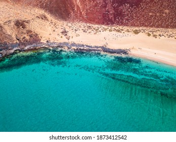 Aerial view of the jagged shores and beaches of La Graciosa island. Bathers on the beach of las Conchas. The main archipelago island Chinijo, a mile northwest of Lanzarote. Canary island. Spain. Ocean