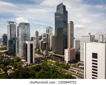 Aerial view of Jakarta business and financial district along the Sudirman avenue with modern skyscrapers in Indonesia capital city in Southeast Asia
