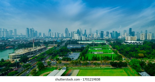 Aerial View of Jakarta Downtown Skyline with High-Rise Buildings With White Clouds and Blue Sky, Indonesia, Asia
