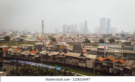 Aerial view of jakarta Indonesia City figuring poor houses in slums like district