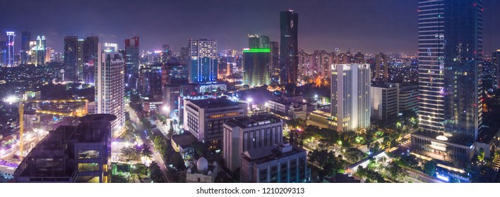 Aerial view of Jakarta's Central Business District (Sudirman and Kuningan), taken at night. Jakarta cityscape. Widescreen/panorama photo.