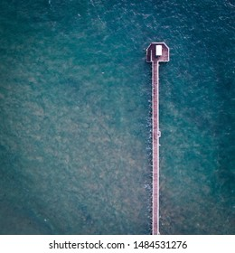 aerial view of a jetty into the ocean