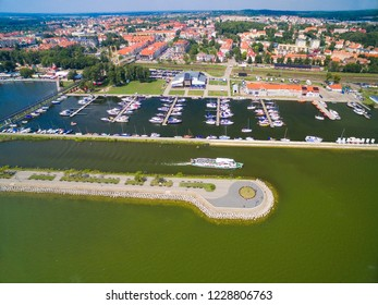 Aerial view of jetty and marina on Niegocin Lake in Gizycko town, Mazury, Poland