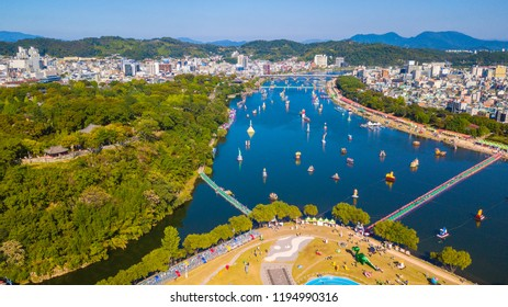 Aerial view of Jinju Namgang Yudeung Festival in Jinju city, South korea. Scenery has many lanterns are floating in the river.