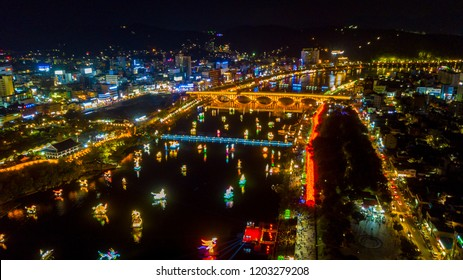 Aerial view of Jinju Namgang Yudeung Festival in Jinju city at night, South korea. Scenery consist of many lanterns there are floating in the river.
