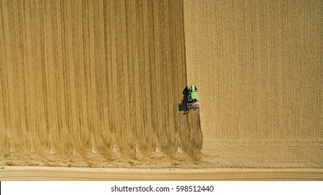 aerial view of John Deere tractor sowing on field in italian countryside. Italy-Pavia 10 March 2017