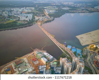 An aerial view of Johor-Singapore Causeway in Johor, Malaysia during sunrise, taken from a drone