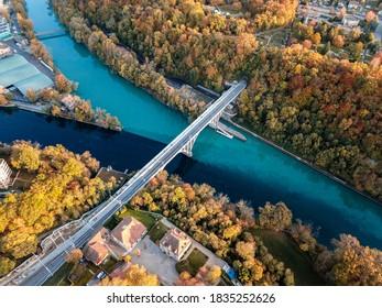 Aerial view of Junction between Rhône and Arve rivers in Geneva, Switzerland, shot in Autumn. Vue aérienne de la Jonction entre les deux rivières prise en automne par un drone, Genève, Suisse. - Shutterstock ID 1835252626
