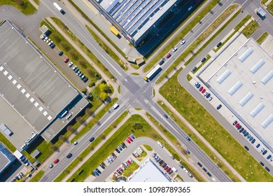 Aerial view of junction in industrial zone and technology park. City infrastructure and traffic from above.