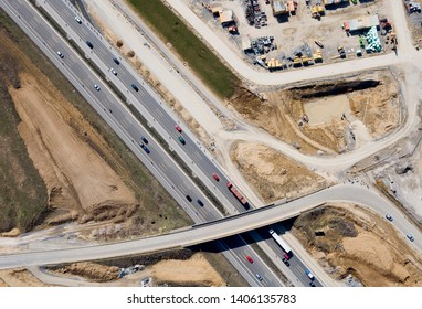Aerial View at Junctions of City Highway. Vehicles Drive on Roads. View From Above / Shot / Photography, (Top View) of Highway Construction Site