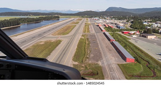 aerial view of the juneau alaska airport from a helicopter showing the runways and seaplane landing inlet