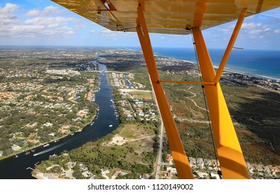 Aerial view of Juno Beach, Florida, with the intracoastal waterway, the Donald Ross drawbridge, and in the distance the Juno Beach fishing pier.