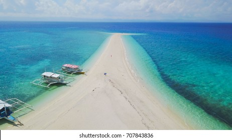 Aerial view at Kalanggaman Island sandbar at Malapascua Island, Cebu, Philippines showing crystal clear blue sea water in sunny day