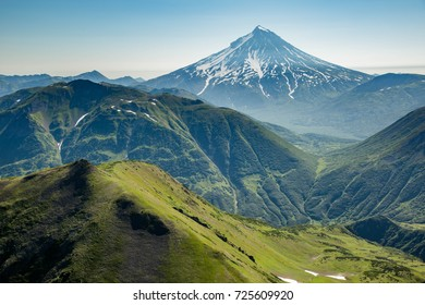 aerial view of Kamchatka volcanos, green valleys, snow and ice and the wonderful view of pure nature