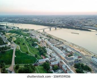 Aerial view of Kanavinsky Bridge across the Oka river from the river side during sunset. Nizhny Novgorod, Russia
