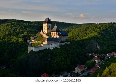Aerial view to The Karlstejn castle. Royal palace founded King Charles IV. Amazing gothic monument in Czech Republic