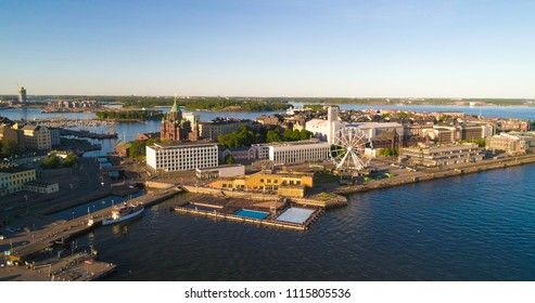 Aerial view of katajanokka, uspetski cathedral and the skywheel, in the city of Helsinki, on a sunny summer evening dusk, in Helsingfors, Uusimaa, Finland