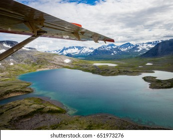 Aerial view of Katmai National Park wilderness from sea plane with lakes and snow capped mountains