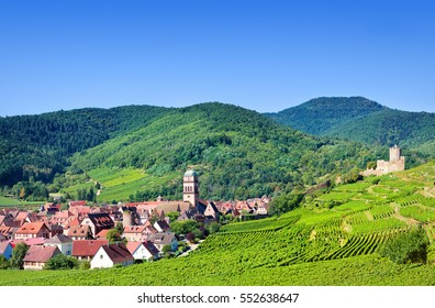 Aerial view to Kaysersberg village and Vosges mountains in the backgroung