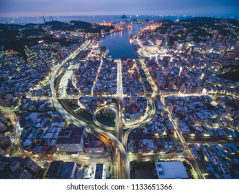 Aerial View of Keelung City Skyline - Port city concept image. Panoramic cityscape birds eye view use the drone in evening, major port city situated in the northeastern part of Taiwan.