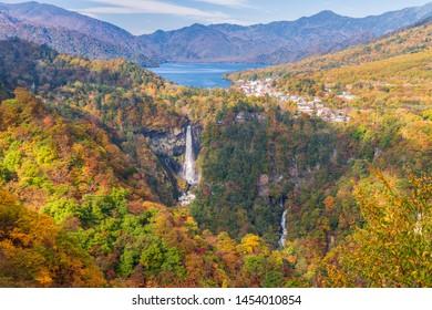 Aerial view of Kegon falls , lake Chuzenji and mountain range during beautiful autumn season, Nikko, Japan.