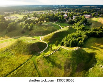Aerial view of Kernave Archaeological site, a medieval capital of the Grand Duchy of Lithuania, tourist attraction and UNESCO World Heritage Site. Sunny summer evening.