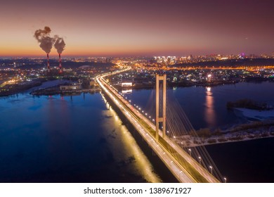Aerial view of Kiev City. Flying over river at night. Ukraine