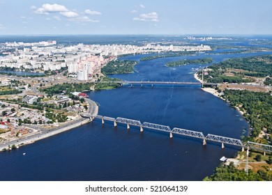 Aerial view of the Kiev (Kyiv) city, Ukraine. Dnieper river with bridges. Obolon district in the background