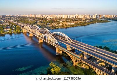 Aerial view of a Kiev Urban Electric Train crossing the Dnieper by the Darnytsia Bridge. Ukraine, East Europe