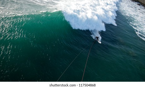 Aerial View of Kitesurfer Surfing a Big Wave