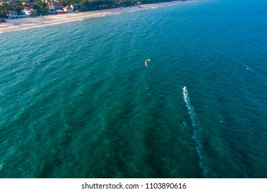 Aerial view of Kitesurfing on the waves of the sea in Mui Ne beach, Phan Thiet, Binh Thuan, Vietnam. Kitesurfing, Kiteboarding action photos
